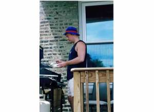 the charming Buckeye grilling on the deck of his Sheffield apartment