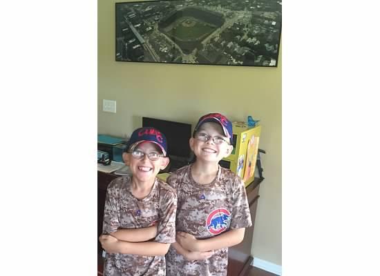 Two Buckeyes showing their Cubbie pride